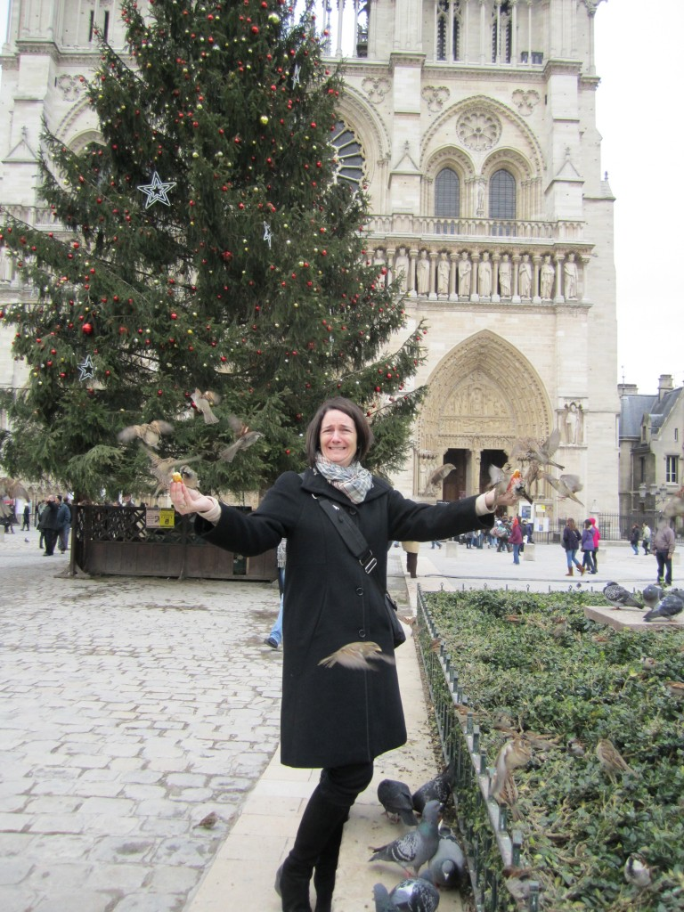Feeding the birds in front of the Christmas tree at Notre Dame. January, 2011