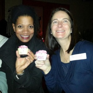 Kim and me at this year's Tweet Up in Paris. We are each holding cupcakes by Sweet Pea Baking and Bertie's Cupcakery. Custom cupcake wrappers with our logos by Katie Shea Design.