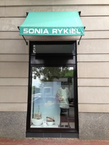 Sonia Rykiel window with bright colors mimicking the flowers across the street in the Boston Public Garden.
