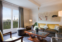 Lovely guest room at the Hotel Lutetia with a peek of the Eiffel Tower.  Photo courtesy of Hotel Lutetia
