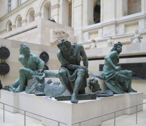 three statues in the Louvre