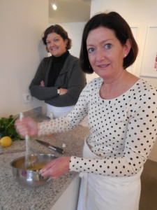 Patty Jenkins whipping up the eggs for the dessert while Susan Ferguson looks on.