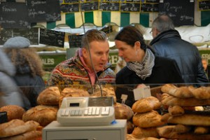 Chef Philippe discussing the food options at the market with Priscilla.