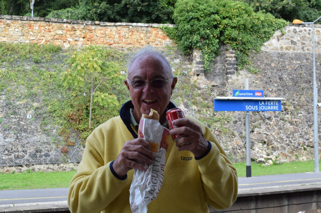 Father Tucker baguette and coke in hand