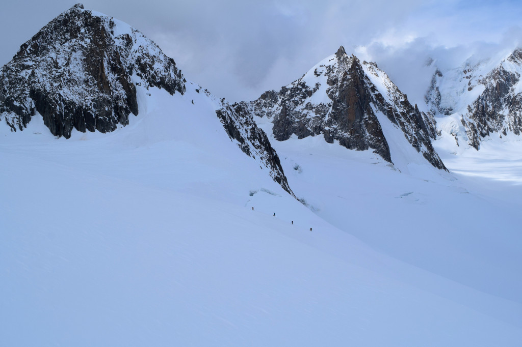 Hikers dot the landscape on their assent up to the peak of Mont Blanc